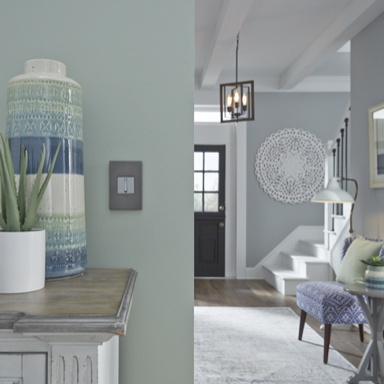 Wall plate in pale blue living room with white and blue accents