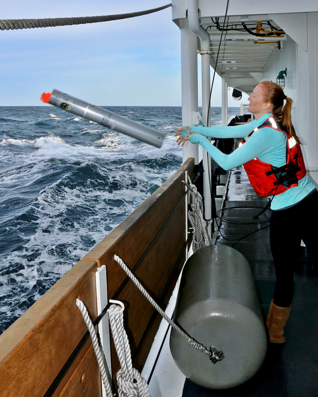 NOAA Fisheries scientist Jessica Crance deploys a sonobuoy to acoustically monitor for North Pacific right whale calls.