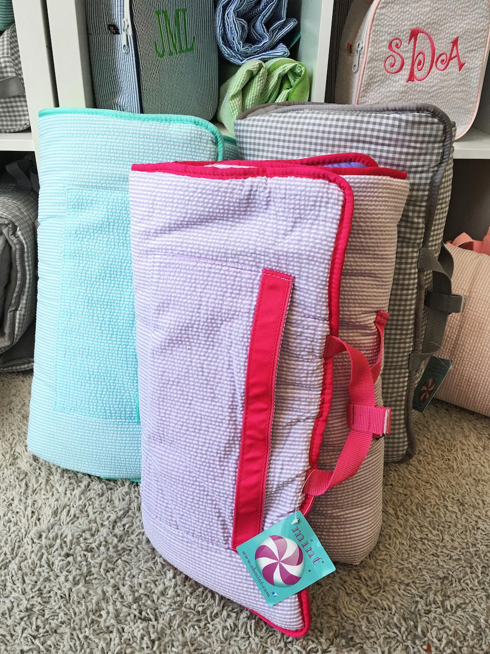 Nap mats, $58 each, at B. Bayer & Co. Monogramming & Gifts
