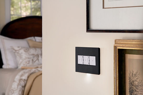 adorne wall plate and light switches installed in bedroom