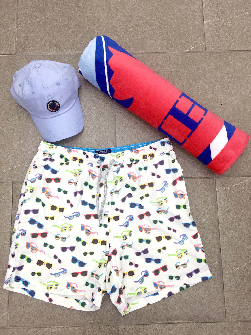 From Remon's: Michael's sunglassesprint bathing suit,$98.50; Southern Tide towel, $49.50; Southern Proper hat, $28