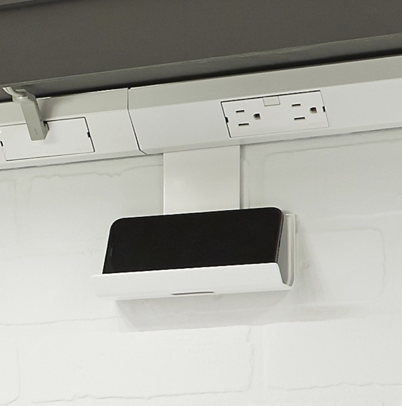 White under cabinet outlets and cradle holding cell phone