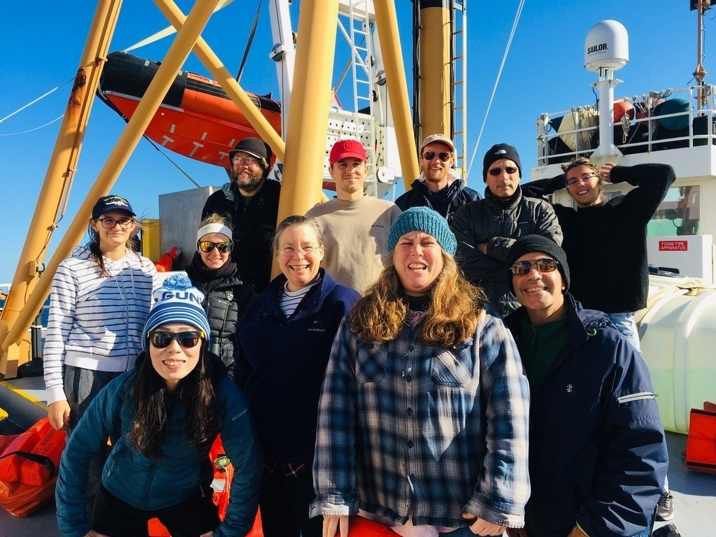 Group photo of scientific party on the deck of a research vessel