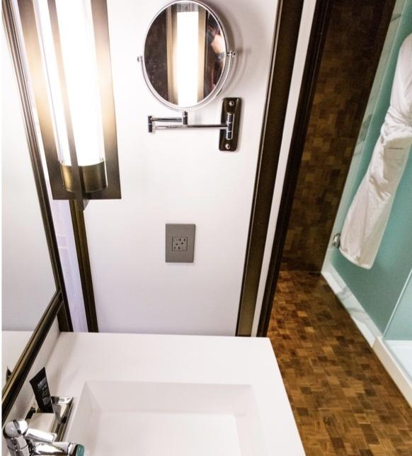 Hotel bathroom with adorne outlet