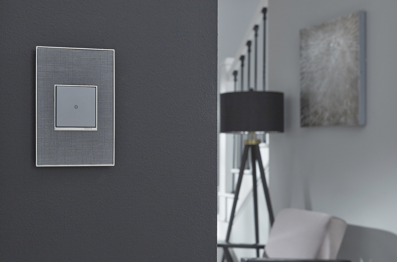adorne Collection by Legrand Touch switch with True Linen designer wall plate in living room
