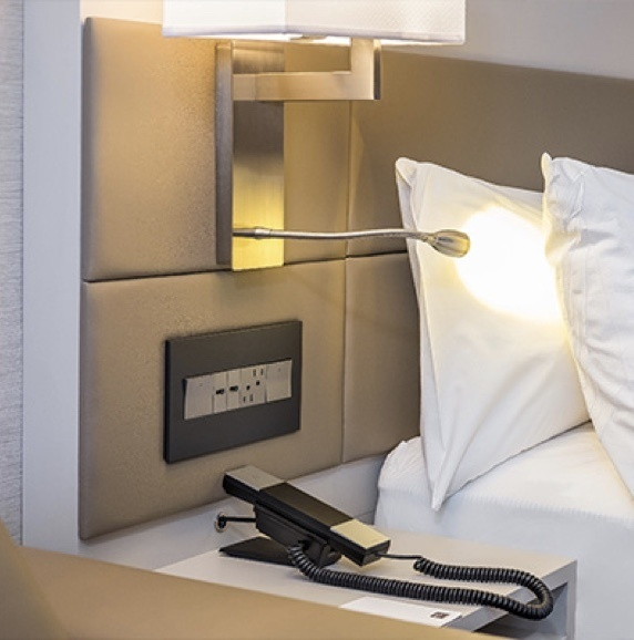 Hotel bed with adorne furniture power in upholstered headboard