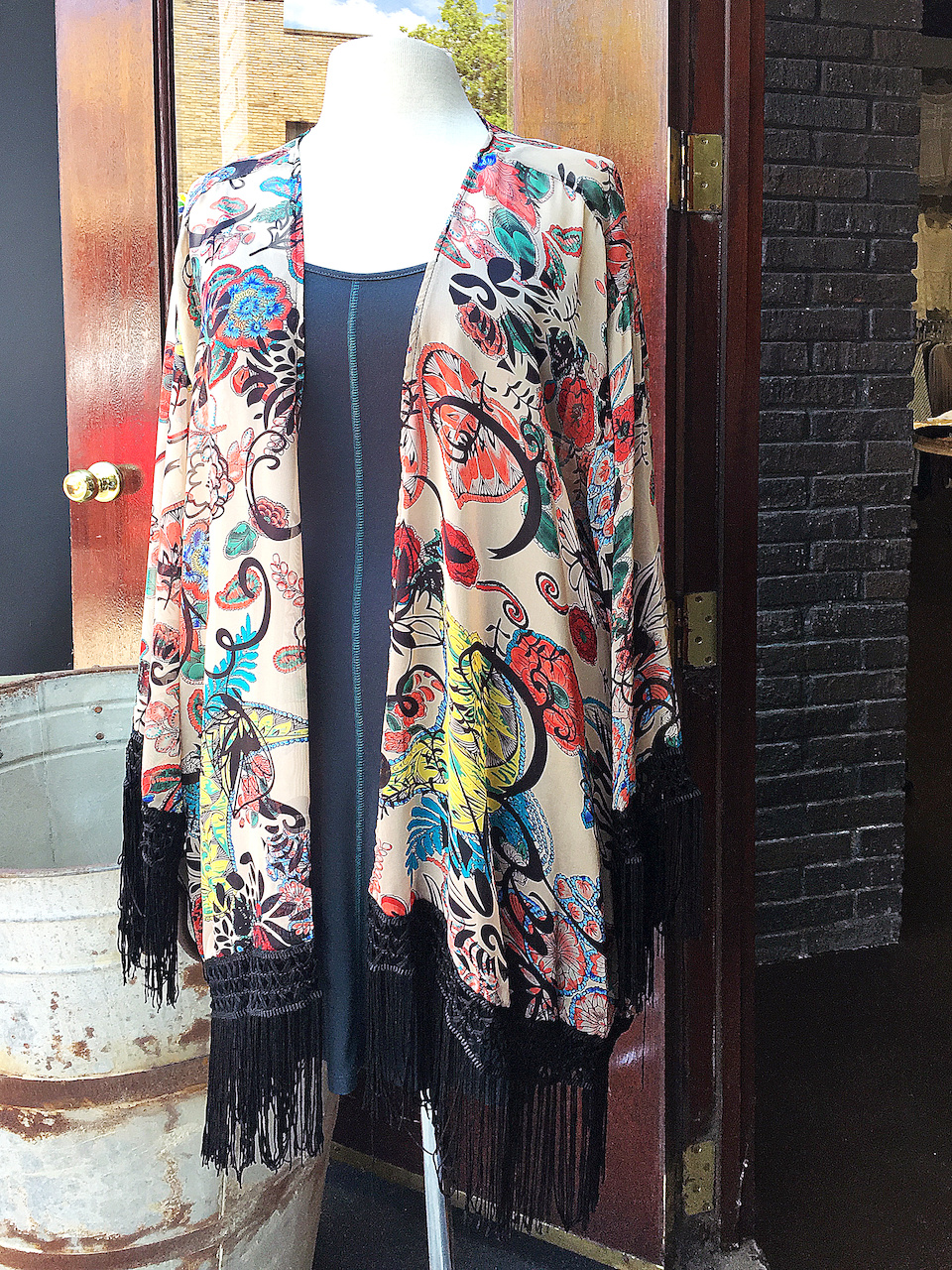 From Ambiance: Multiprint fringe kimono, $44; teal tank dress, $39