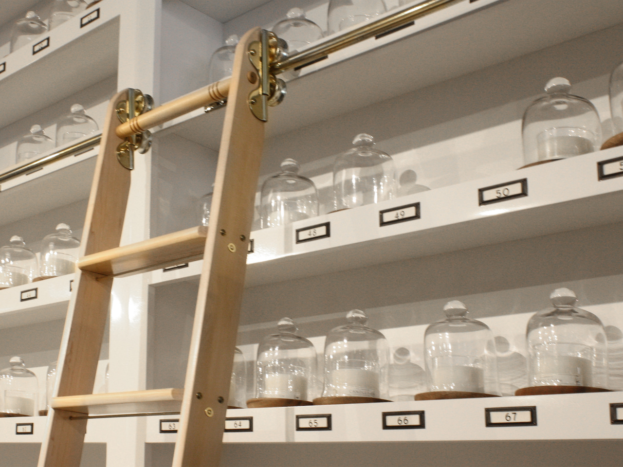 This library ladder is a focal point of the store and helps chandlers climb to the tip-top of the Candlefish library.