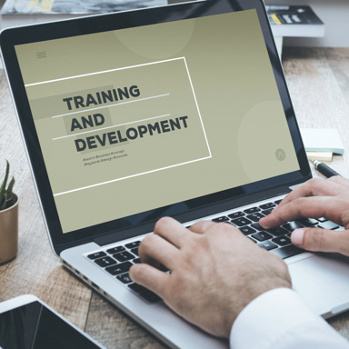 "laptop screen displaying the text ""Training and Development"""