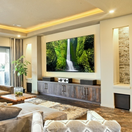 Modern tuscan home with flatscreen tv in family room
