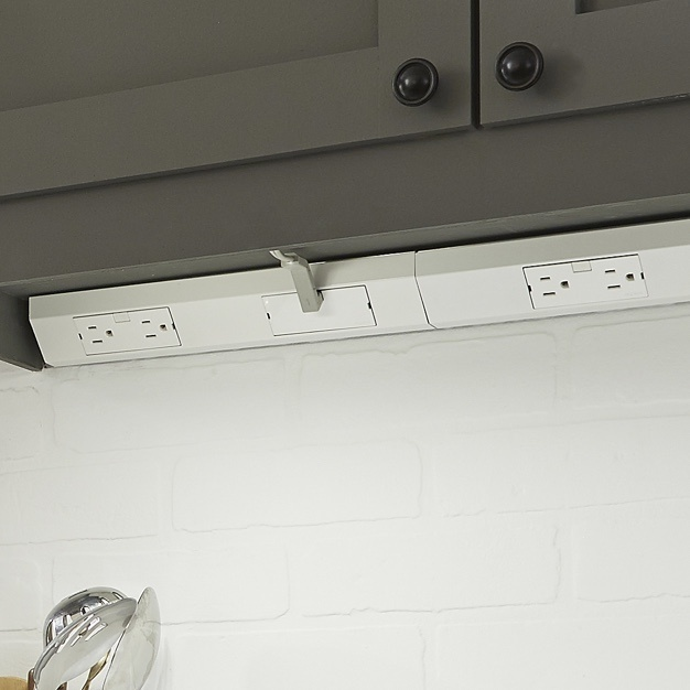White modular track with outlets under kitchen cabinets