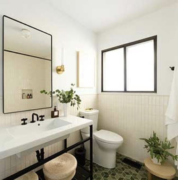newly renovated bathroom with adorne Collection by Legrand designer outlets and switches