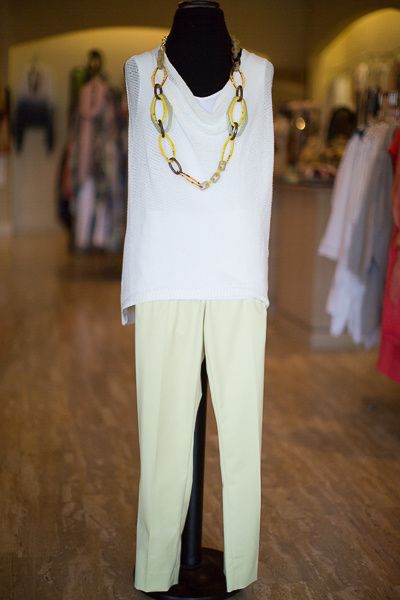 From Coming Attractions: Long white layering tank, $58; Bobeau white fishnet knit cotton sleeveless top, $80; Peache of Cloth straight leg, front-zip pants in margarita; lucite link necklace, $90.