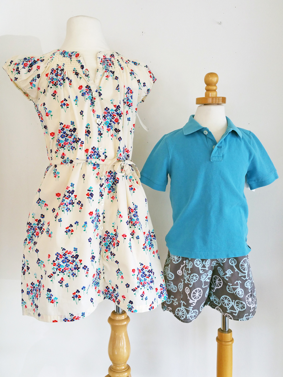 Floral dress, $11.97; Crewcuts polo shirt, $10.47 and bicycle shorts, $7.77, at Little Lavender