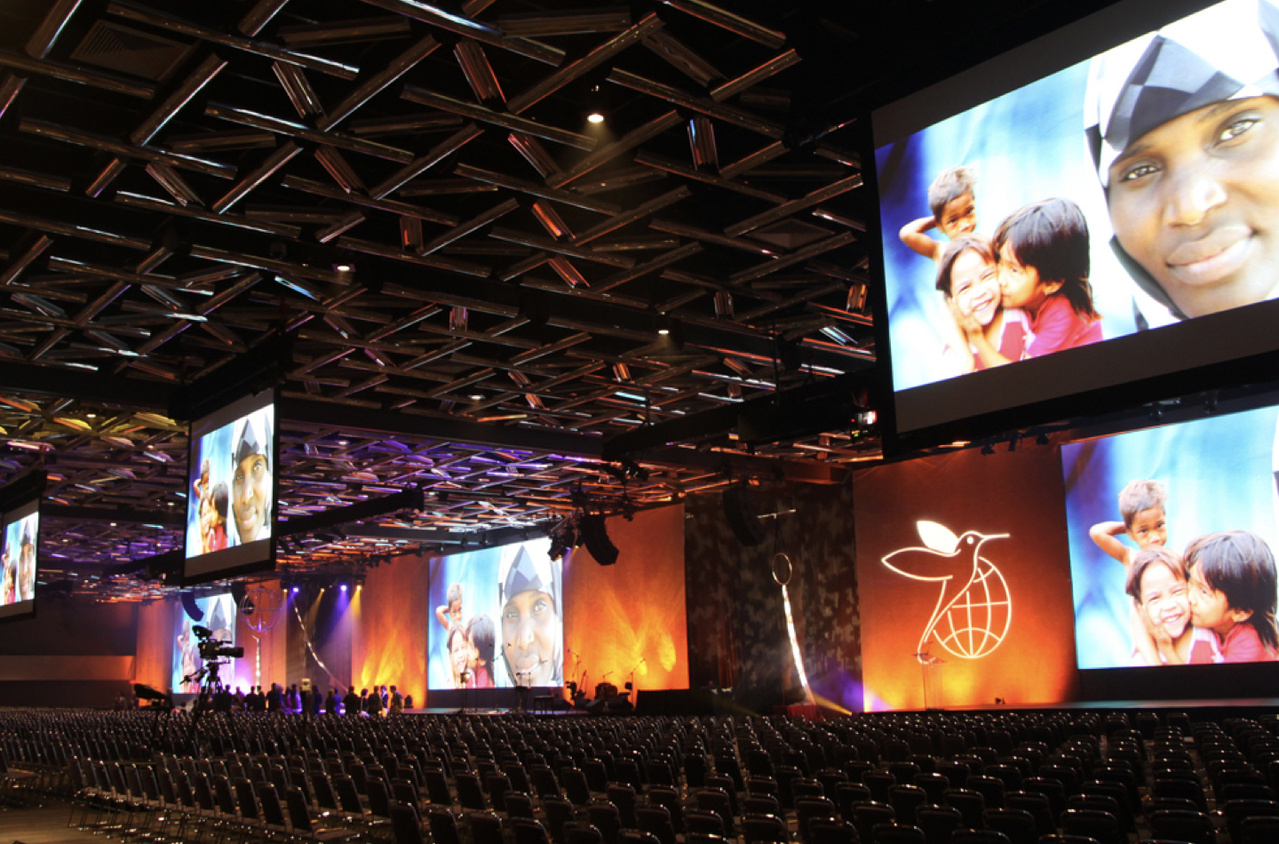 Desktop image of Projecta projector screens at a large conference