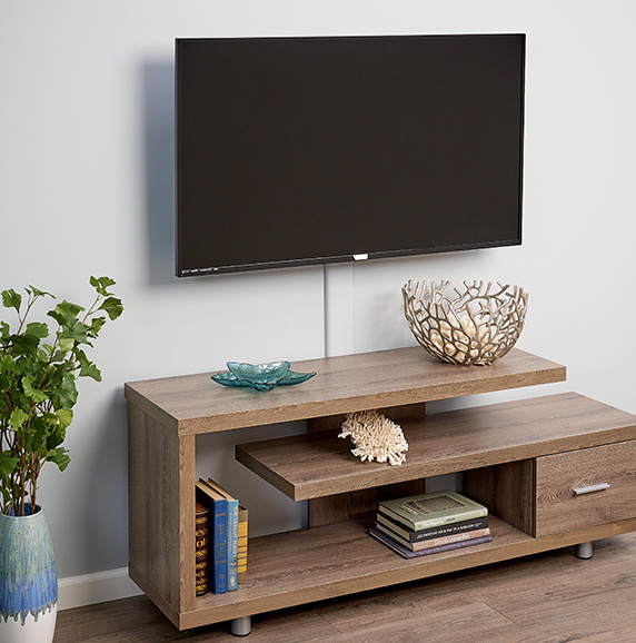 wooden entertainment center with wall mounted flat screen television above
