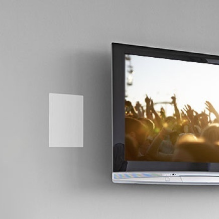 Gray wall with tv mounted on wall