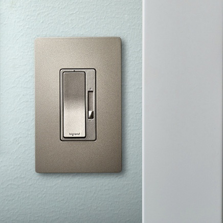 Dimmer switch installed in light blue wall