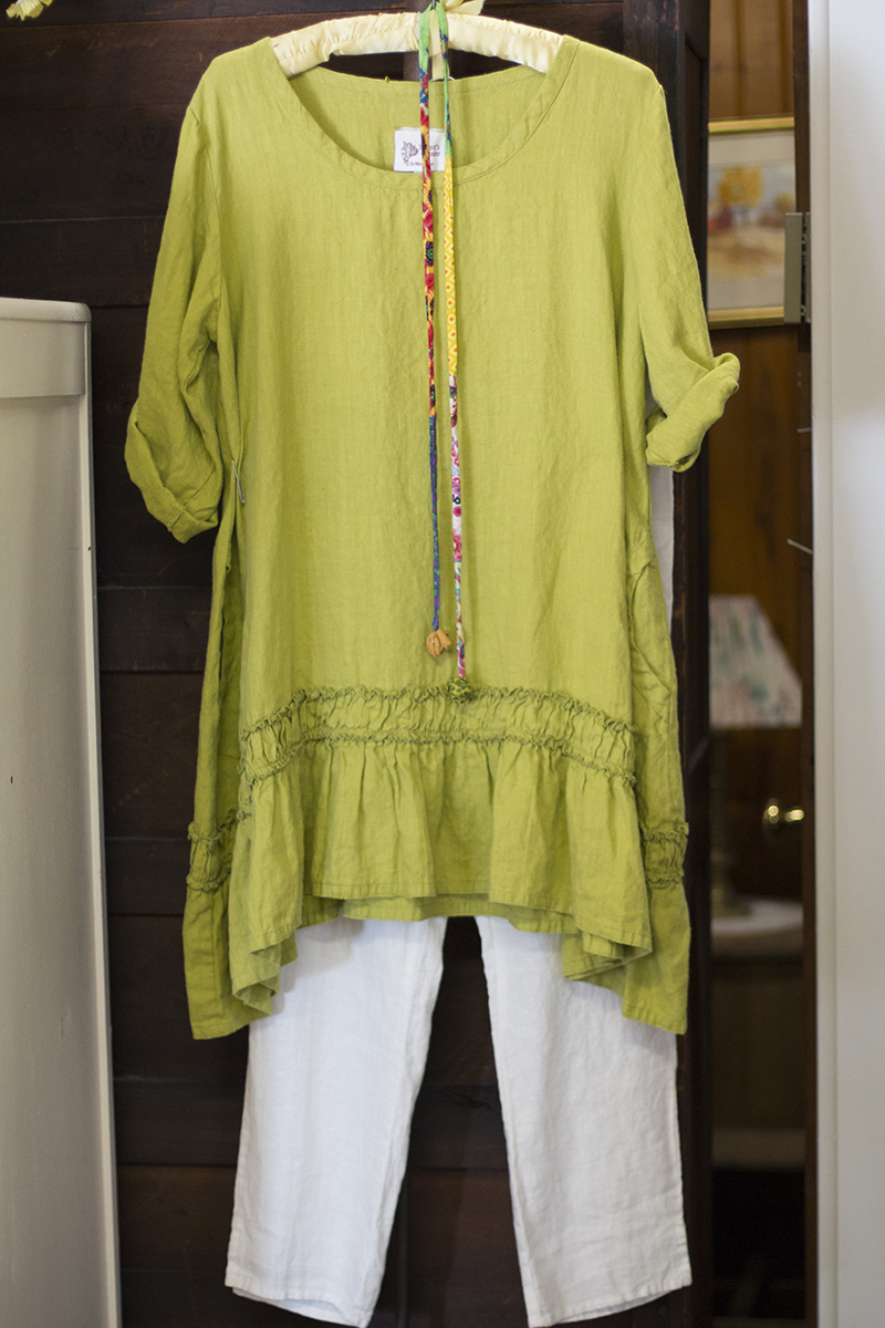 Flax green linen tunic, $166; Flax white linen pants, $62; Patterned necklace, $18