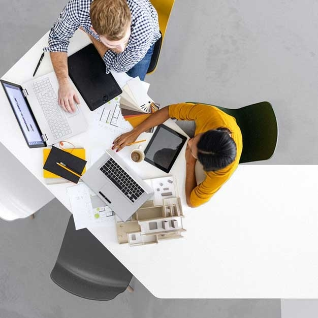 Overhead shot of coworkers at a desk