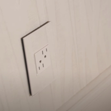 White outlet against white wall from top angle