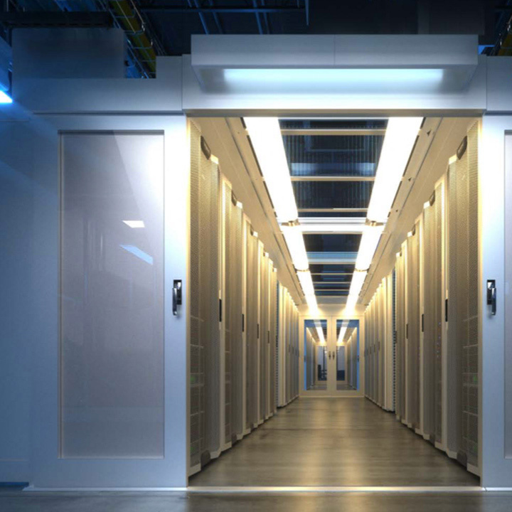 Open entrance with white doors to a long hallway, with computer servers on either side