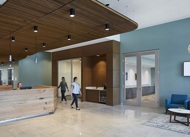Lobby area with individuals walking through