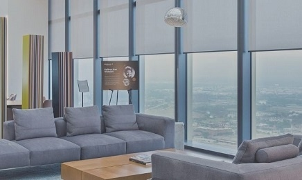 Seating area in commercial high rise building with large shaded windows