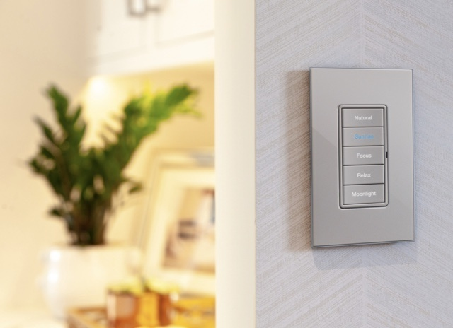 LHUMAN lighting control on wall with warm tones in background