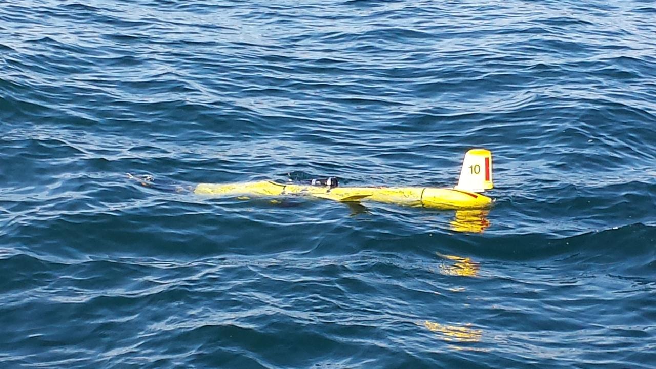 Underwater glider deployed in ocean.