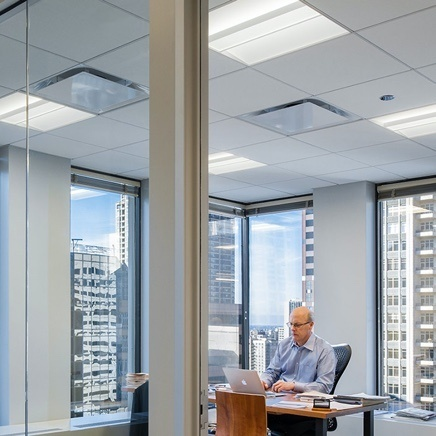 Well lit glass office, city window view