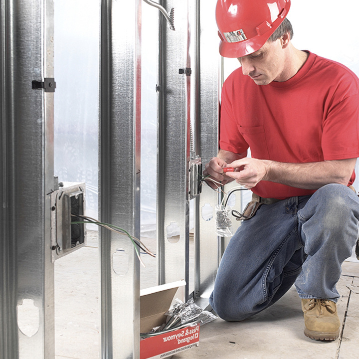 contractor installing electrical outlet