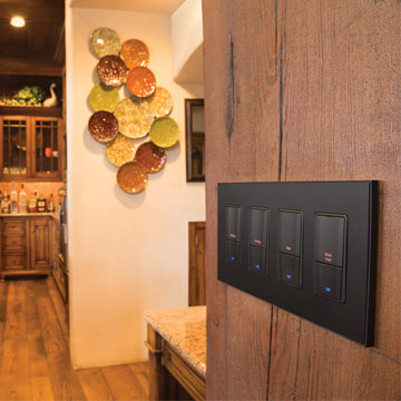 Keypads on wooden wall in kitchen area