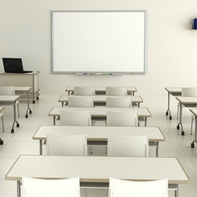Class room with white desks and white chairs