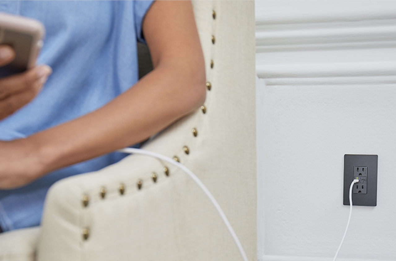 phone plugged into adorne collection power delivery usb charging outlet