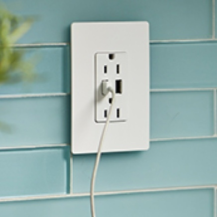 radiant USB outlet installed in blue tile backsplash