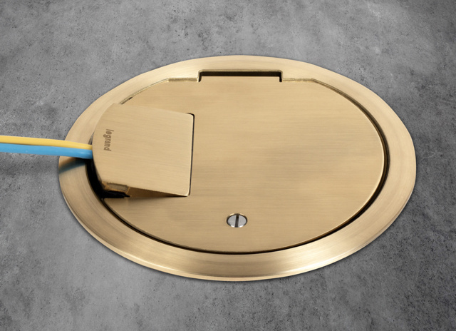Evolution poke-thru brass heavy-duty cover installed in concrete surface