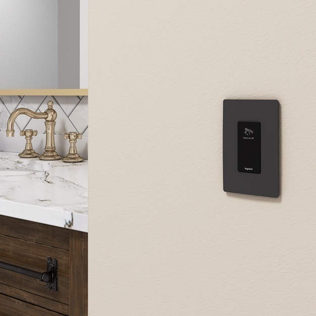 white radiant switches and dimmer against gray wall in living room