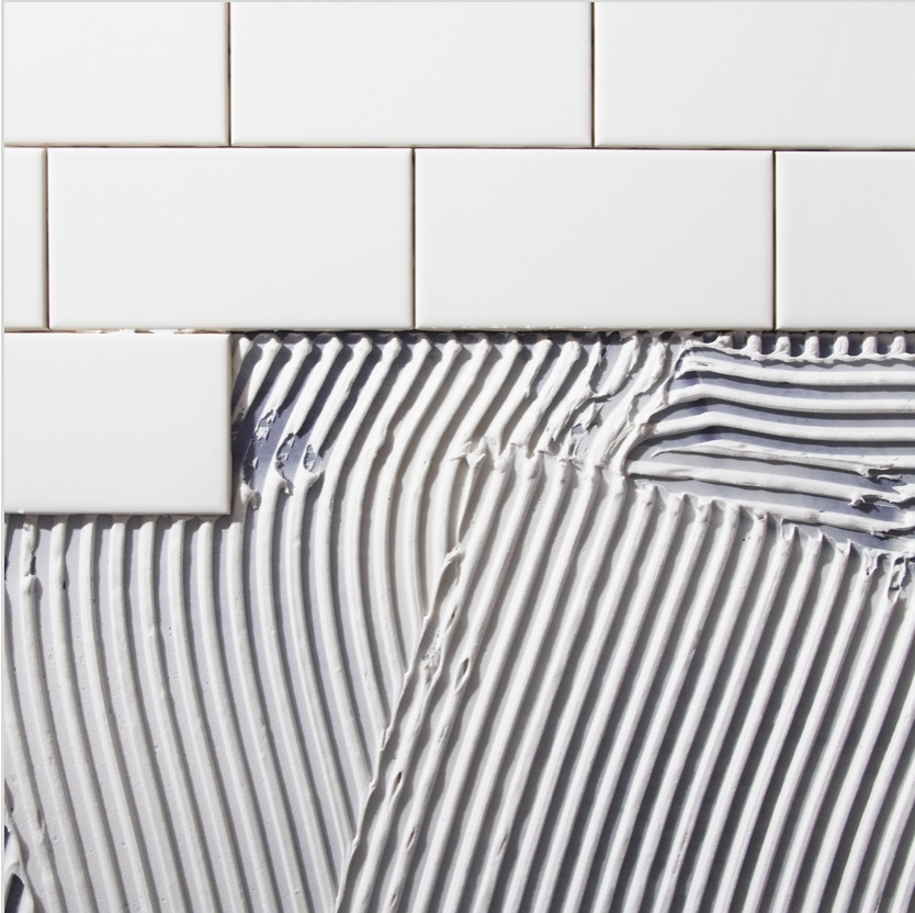 blue and white pinstripes on white subway tile
