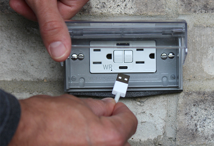 cord being plugged into gfci usb weather resistant outlet