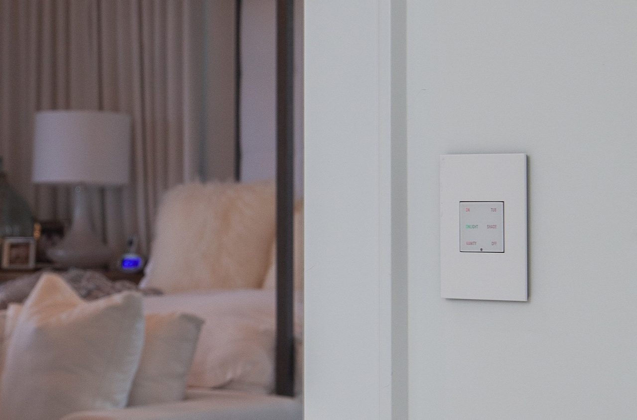 light control panel on white bedroom wall