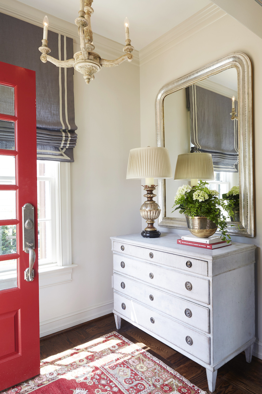 """""""It was important to keep the color theme in the crimson and gray as family and friends gather to tailgate for the Alabama games,"""" says Libby of the """"Game Day"""" house. """"I wanted a calming overall neutral palette with pops of crimson!"""""""