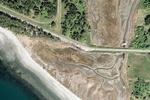 Aerial photo shows a road cutting through a rural landscape
