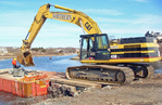 Heavy construction equipment used during a dam removal
