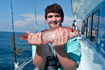 A recreational angler holds a vermilion snapper.