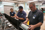 three scientists working on lab ocean acidification trays