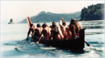 Makah tribal members paddle whaling canoe.