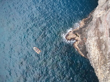 Researchers use an unmanned aerial systemto look for seals on a difficult ledge at Nihoa(Photo: NOAA Fisheries)at