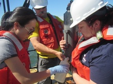 yuan liu collecting water samples with colleagues.