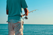 A recreational angler holds a fishing rod.